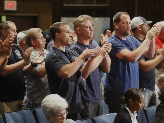 A cheering crowd saluted the failed effort to cut funding to the city fire department. Council President Theo Gregory had called a special meeting in an attempt to override the mayor's veto of the council's cuts.