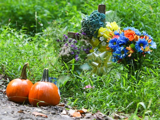 Cars drive by a memorial near the site of the fatal hit-and-run accident along Brackenville Road in Hockessin Monday, Sept. 15, 2014.