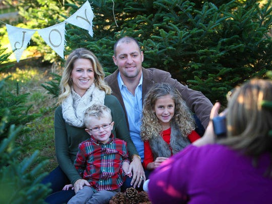 Chris and Missy Modarelli with their children, Olivia, 6, and Dominic, 3, with photographer Jami Jones at Schmidt's Tree Farm in Landenberg, Pa.
