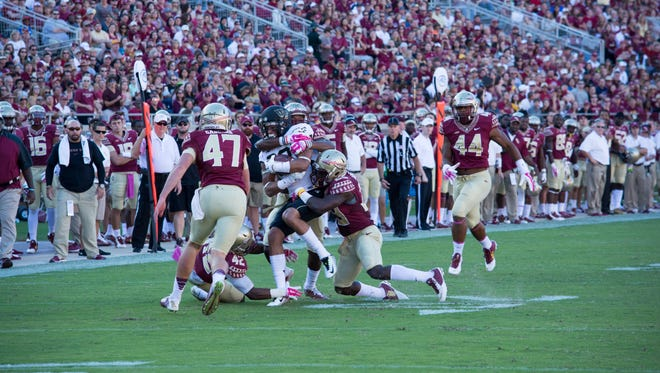 Stephen Gabbard (47), DeMarcus Walker (44),  and The Florida State Seminoles defeated the Wake Forest Demon Deacons by a score of 43-3 at Doak S. Campbell Stadium in Tallahassee, FL on Sat., Oct. 4.