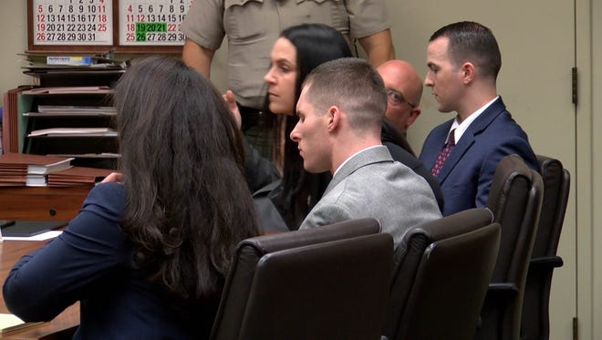 Robert Pape, seated right, and Cristin Smith, seated back to camera, await the reading Thursday of a Riverside County jury's verdict.