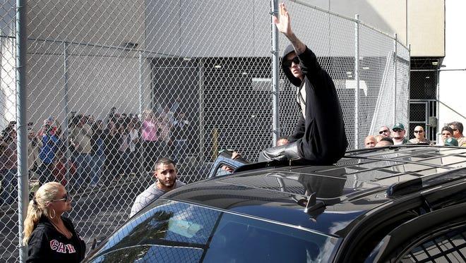 Performer Justin Bieber leaves a Miami jail Thursday.