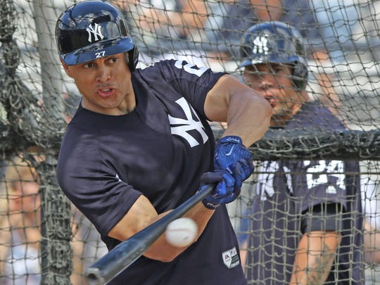 Giancarlo Stanton contacts with the ball during batting