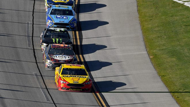 Joey Logano, front, leads the Ford cars of Kevin Harvick, Kurt Busch and Ricky Stenhouse Jr. in the closing laps of Sunday's GEICO 500 at Talladega Superspeedway.