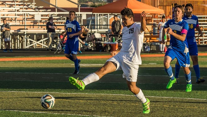Aztec's Fransisco Villegas scores a goal against Bloomfield on Thursday at Fred Cook Memorial Stadium in Aztec.