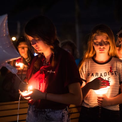 Nearly a hundred people attend a candlelight vigil