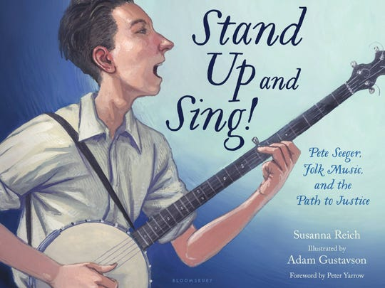 """Stand Up and Sing! Pete Seeger, Folk Music, and the Path to Justice"" by Susanna Reich, illustrated by Adam Gustavson, foreword by Peter Yarrow."