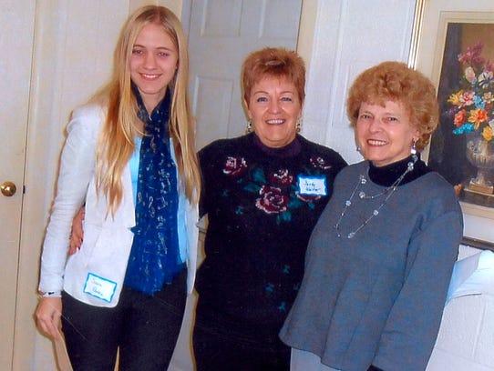 (From left) Sara Penka; Sandy Walter, chairman of the