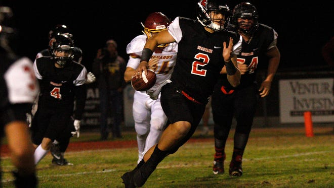 Rio Mesa quarterback Austin Maciel finds some running room during the Spartans' loss to top-seeded El Modena on Friday night in a Division 8 quarterfinal game at Rio Mesa High.