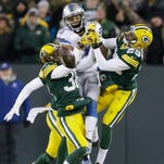 Green Bay Packers' Tramon Williams (38) and Casey Hayward break up a pass intended for Detroit Lions' Golden Tate during the second half of an NFL football game Sunday, Dec. 28, 2014, in Green Bay, Wis. The Packers won 30-20.