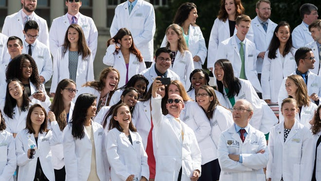 University of Rochester School of Medicine & Dentistry Dean David Lambert takes a selfie as first-year med students assemble for a photo on the quad steps after the annual white-coat ceremony in August 2017.