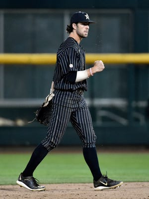 Vanderbilt's Dansby Swanson celebrates after beating Virginia 5-1 in Game 1 of the best-of-three NCAA baseball College World Series finals at TD Ameritrade Park in Omaha, Neb., Monday, June 22, 2015.