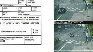 Example of a ticket from a summons issued to a driver in Yonkers who was caught by a red light camera at the intersection of Central Park Avenue and McLean Avenue in Yonkers. (file)