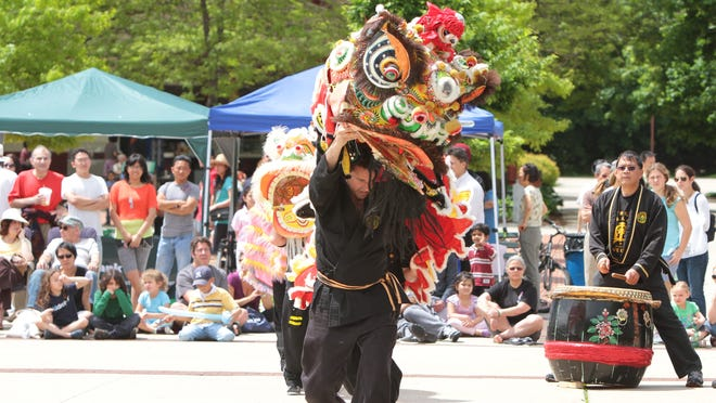 A dancing dragon performs during the 12th annual Asian-American Heritage Celebration at Kensico Dam Plaza in Valhalla . The day's festivities included live performances of the music and dance of many Asian countries, including China, Japan, Korea, the Philippines, Malaysia, Indonesia and Burma. Also, Asian arts, cultural and religious exhibits, health screenings and plenty of foods.( Matthew Brown / The Journal News )