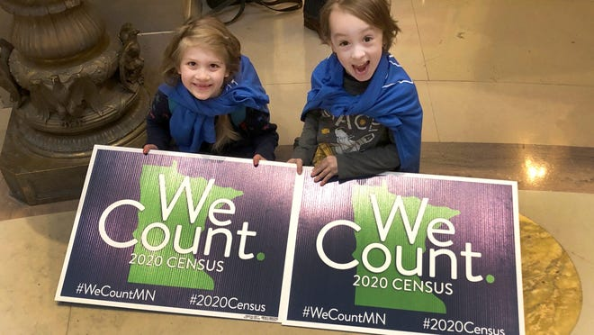 Noelle Fries, 6, left, and Galen Biel, 6, both of Minneapolis, attend a rally at the Minnesota Capitol on Monday, April 1, 2019, to kick off a year-long drive to try to ensure that all Minnesota residents are counted in the 2020 census. Response rates in poor and minority neighborhoods have dropped this year.