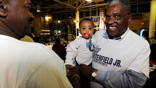 Robert Porterfield Jr., Montgomery County School Board, holds his granddaughter Lauren Grace at a Democratic Party watch party at the East Blvd. Ramada Inn in Montgomery, Ala. on Tuesday evening November 4, 2014.