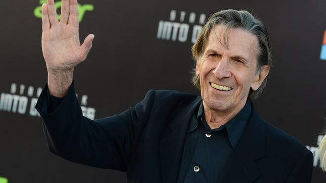 """In this May 14, 2013 file photo, Leonard Nimoy arrives at the LA premiere of """"Star Trek Into Darkness"""" at The Dolby Theater in Los Angeles. Nimoy, famous for playing officer Mr. Spock in """"Star Trek"""" died today, Friday, in Los Angeles of end-stage chronic obstructive pulmonary disease. He was 83."""