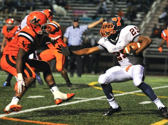 William Penn running back Dakeem Dennison (25) looks for running room around Northeastern's Jordan Kearse (1) on Friday night. The Bearcats picked up their first win of the season with a 28-13 triumph over the host Bobcats. (For the Daily Record/Sunday News -- Mike Zortman)