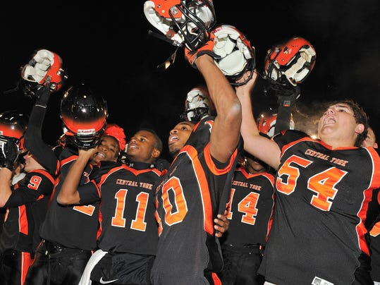 Central York players celebrate their 33-28 win vs. Chambersburg on Friday in the District 3 Class AAAA playoffs. (For the Daily Record/Sunday News -- Mike Zortman)