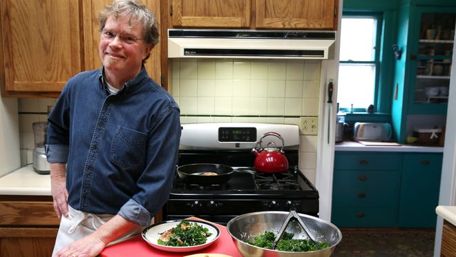 """Dan Eaton in his kitchen where he created meals for viewers of his """"Cooking at Home"""" show."""