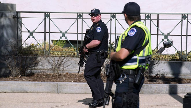 Police stand guard outside the Capitol in Washington, Monday, March 28, 2016. Capitol Police officers say a man was shot by police after drawing a weapon at a U.S. Capitol checkpoint. He was taken to the hospital.