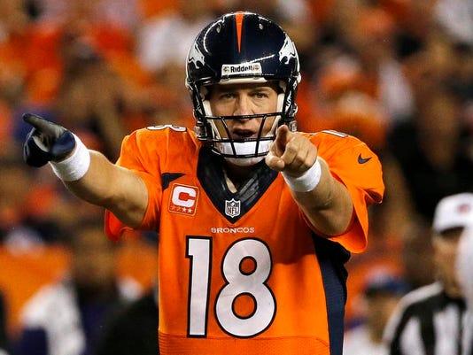 -Manning Sports Illustrated Football.JPEG-02135.jpg_20131215.jpg