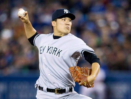 APTOPIX BBA Yankees Blue Jays