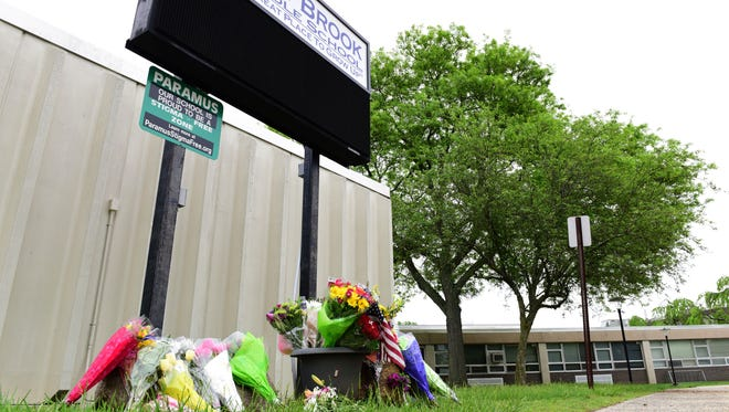 A memorial for the victims of the fatal bus crash at East Brook Middle School in Paramus on Friday May 18, 2018. A school bus transporting fifth grade students from East Brook Middle School to a field trip collided with a dump truck, killing one student and one teacher on Route 80 in Mount Olive.