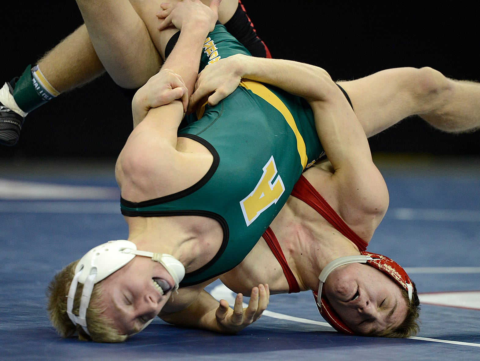 Ashwaubenon's Zac Benton battles Pewaukee's Isaac Lodise in their 138-pound Division 1 consolation semifinal match during the WIAA individual wrestling state tournament Friday at the Kohl Center in Madison. Lodise won the match. Evan Siegle/Press-Gazette Media