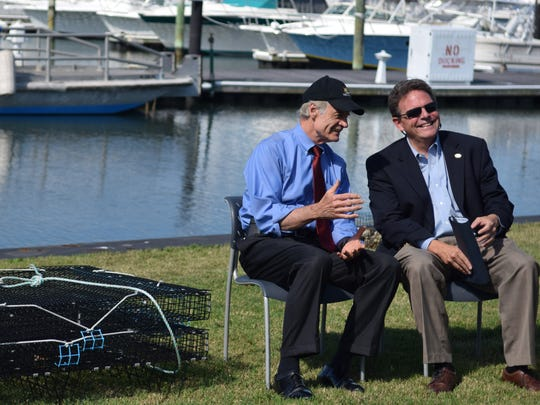 Sen. Tom Carper talks to Delaware Department of Natural Resources and Environmental Control Secretary David Small at a event discussing federal grants to benefit research for aquaculture.