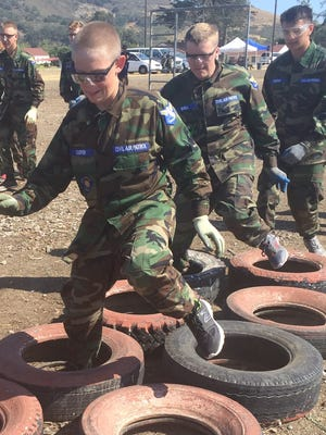 Civil Air Patrol Cadet Christopher Cooper, 13, of Yucca Valley (front) makes his way through the tire obstacle during training at the California Wing Encampment at Camp San Luis Obisbo (June 24 - July 1 2016). Christopher is a member of Palm Springs Composite Squadron 11.