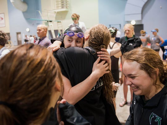 Fossil Ridge High School swimmer Caraline Baker embraces a teammate during the Colorado High School Activities Association Girls Class 5A State Championships held Feb. 10, 2017, at the Veterans Memorial Aquatics Center in Thornton. Baker plans to swim for the University of Southern California.