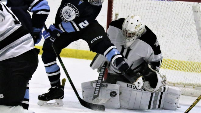 Standing his ground during a 2016-17 game is Plymouth goalie Brendan Olepa (1).