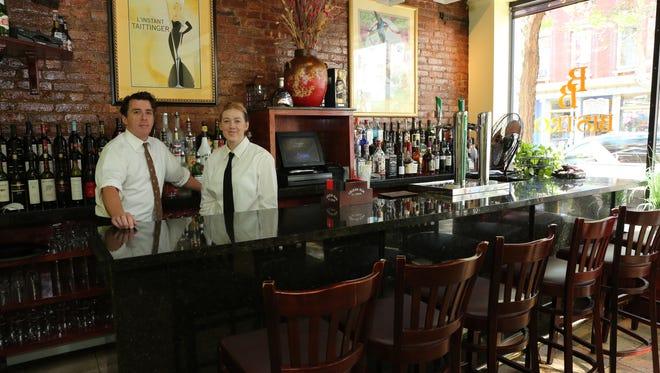 Tom Stratford and Jane Engel tend bar at Broadway Bistro in Nyack.
