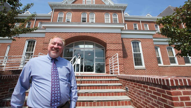 Robert Bernstein stands in front of the administration building at the Delaware Department of Health and Social Services Thursday. Bernstein was appointed by a federal judge in 2011 to monitor Delaware's efforts to reform its mental health system.