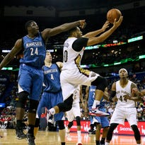 Mar 29, 2015; New Orleans, LA, USA; New Orleans Pelicans guard Eric Gordon (10) shoots against Minnesota Timberwolves forward Anthony Bennett (24) during the second half of a game at the Smoothie King Center. The Pelicans defeated the Timberwolves 110-88. Mandatory Credit: Derick E. Hingle-USA TODAY Sports