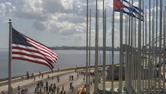 The U.S. flag waves Aug. 14 outside the newly opened U.S. Embassy, near a Cuban flag overlooking Havana's seaside boulevard, the Malecon, in Cuba. The Stars and Stripes rose over the newly reopened U.S. Embassy after a half-century of often-hostile relations.