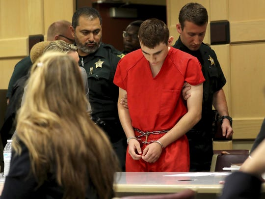 Nikolas Cruz appears in court for a status hearing before Broward Circuit Judge Elizabeth Scherer Monday, Feb. 19, 2018, in Fort Lauderdale, Fla. Cruz is facing 17 charges of premeditated murder in the mass shooting at Marjory Stoneman Douglas High School in Parkland, Fla. (Mike Stocker/South Florida Sun-Sentinel via AP, Pool)