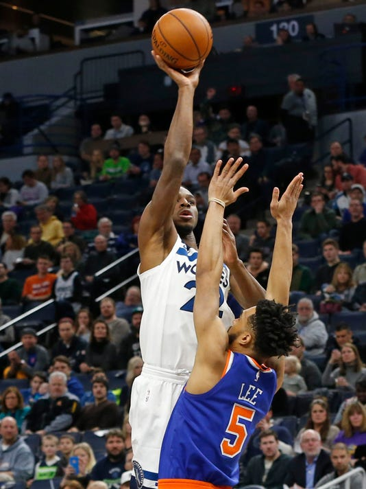 Minnesota Timberwolves' Andrew Wiggins, top, shoots over New York Knicks' Courtney Lee in the first half of an NBA basketball game Friday, Jan. 12, 2018, in Minneapolis. (AP Photo/Jim Mone)