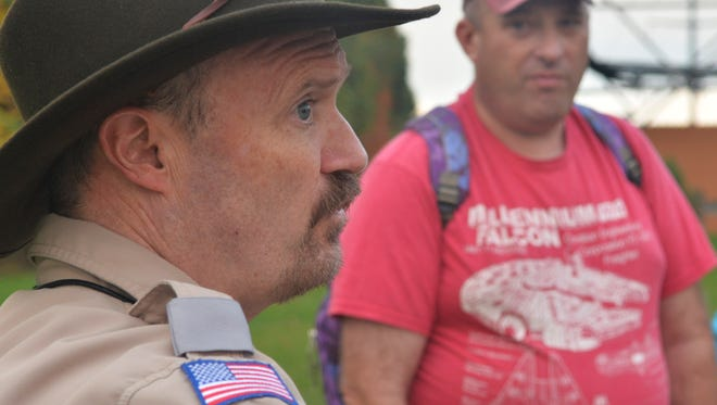 Keith Alder of Hackettstown, right, listens to the yarns as lifelong Cedar Grove resident and Boy Scout leader Bob Cunniff leads the annual Cedar Grove Ghost Tour, a fundraiser for Boy Scout Troop 65, on Oct. 21, 2016.