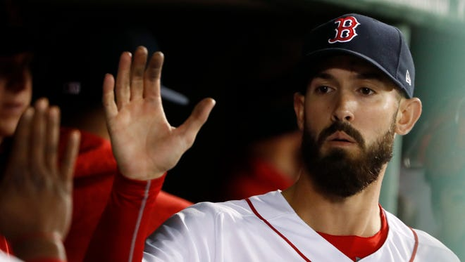 Boston Red Sox starting pitcher Rick Porcello is congratulated in the dugout after leaving the game the baseball game against the New York Yankees following the seventh inning at Fenway Park in Boston Thursday, April 12, 2018.
