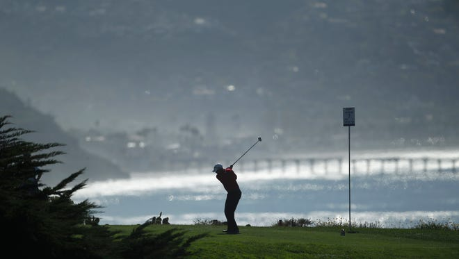 Josh Teater tees off on the seventh hole of the North Course at Torrey Pines during the opening round of the Farmers Insurance Open golf tournament in San Diego on Jan. 26, 2012.