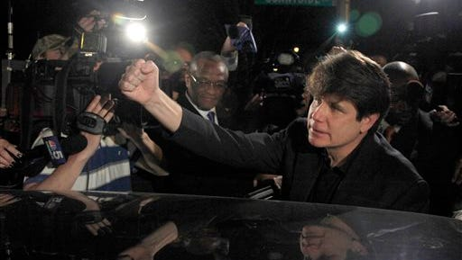 """In this March 15, 2012 file photo, former Illinois Gov. Rod Blagojevich departs his Chicago home for Littleton, Colo., to begin his 14-year prison sentence on corruption charges. Robert Blagojevich the brother of imprisoned former Illinois Gov. Rod Blagojevich offers fresh details in a new book to back his contention prosecutors used him as a pawn to get his younger sibling on charges he sought to hock President Barack Obama's old U.S. Senate seat. While charges were eventually dropped against him, the Tennessee businessman, says his refusal to turn on his brother made him """"collateral damage"""" of an overzealous prosecution that cost his reputation, $1 million in legal bills and a still-unrepaired family split."""
