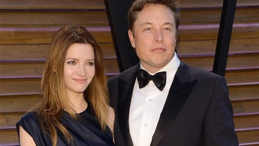 In this file photo, Talulah Riley, left, and Elon Musk attend the 2014 Vanity Fair Oscar Party, in West Hollywood, Calif. Musk and his wife are divorcing for a second time. The entrepreneur and his wife, Riley, issued a joint statement Wednesday announcing they are splitting amicably after they remarried in July 2013 following their previous breakup.