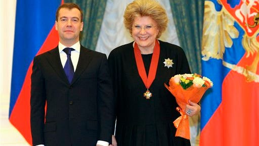 In this 2009 file pool photo, the then Russian President Dmitry Medvedev, left, and mezzo-soprano Elena Obraztsova pose for a photo during an award ceremony at Yekaterininsky (St. Catherine's) hall in the Moscow Kremlin. Obraztsova died Monday in Germany, where she was undergoing medical treatment. She was 75.