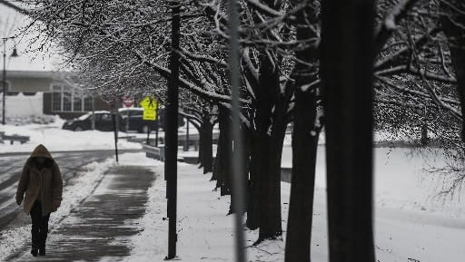 File Photo - A student walks near Washington Street in Gettysburg on Wednesday Jan. 21, 2015 after more than two inches of snow fell on the Adams County region in the morning and afternoon.