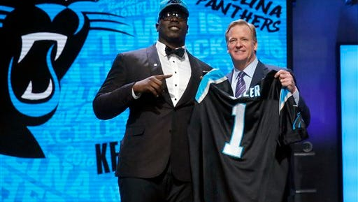 Louisiana Tech's Vernon Butler poses for photos with NFL Commissioner Roger Goodell after being selected by the Carolina Panthers as the 30th pick in the first round of the 2016 NFL football draft, Thursday, April 28, 2016, in Chicago. (AP Photo/Charles Rex Arbogast)