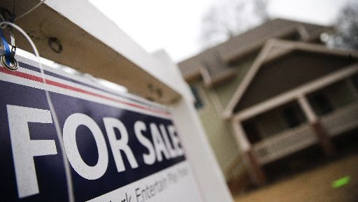 """A """"For Sale"""" sign hangs in front of an existing home in Atlanta in early 2016. Mortgage rates have seen an uptick since the presidential election."""