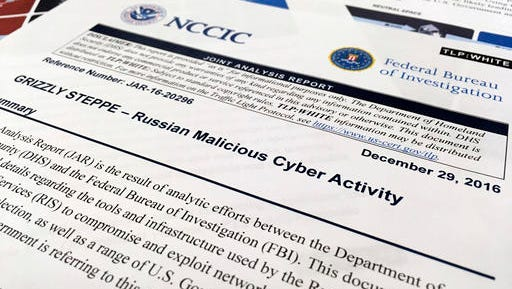 The first page of the Joint Analysis Report narrative by the Department of Homeland Security and federal Bureau of Investigation and released on Dec. 29, 2016, is photographed in Washington, Jan. 6, 2017. Computer security specialists say the technical details in the narrative that the U.S. said would show whether computers had been infiltrated by Russian intelligence services were poorly done and potentially dangerous. Cybersecurity firms ended up counseling their customers to proceed with extreme caution after a slew of false positives led back to sites such as Amazon and Yahoo Inc. Companies and organizations were following the government's advice Dec. 29 and comparing digital logs recording incoming network traffic to their computers and finding matches to a list of hundreds of internet addresses the Homeland Security Department had identified as indicators of malicious Russian intelligence services cyber activity.