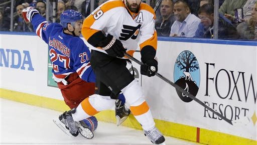 Philadelphia Flyers' Scott Hartnell (19) looks to pass after checking New York Rangers' Ryan McDonagh (27) during the first period of Game 1 of an NHL hockey first-round playoff series on Thursday, April 17, 2014, in New York. (AP Photo/Frank Franklin II)